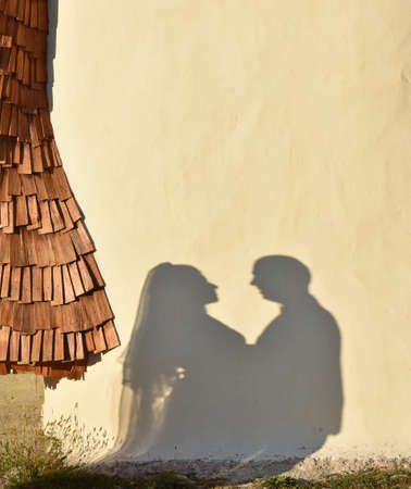 Married couple silhouette on wall