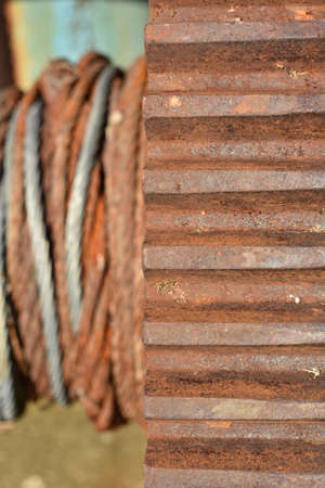 Rusty steel wheel with old steel cable Stock fotó