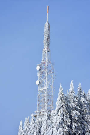 Steel telecommunication tower on heavy snow