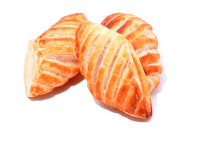 Backed apricot cakes isolated on white background