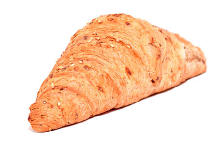 Croissant with seeds on white background