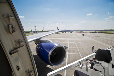 openspace: Wing and the turbine of the plane at the airport