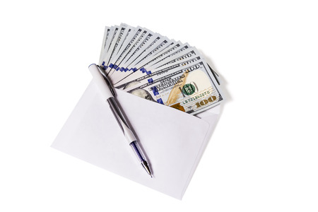 payola: Hundred dollar bills are in an open envelope, top pen isolated on white background