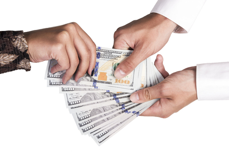 lend a hand: Female hand pulls out a hundred dollar bill from the man Stock Photo