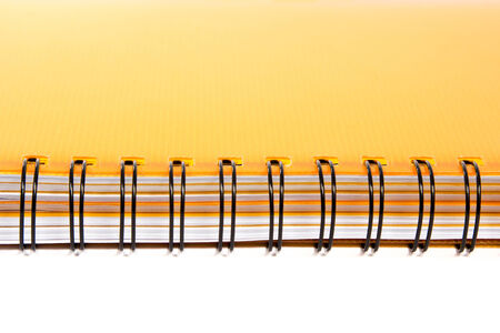Metal hardcover placed horizontally orange writing book on a white background photo