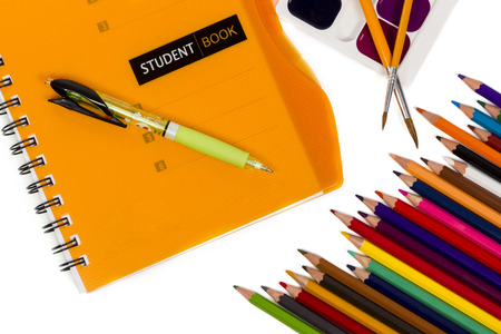 notepad, pen, a set of paints and a set of pencils isolated on white background photo