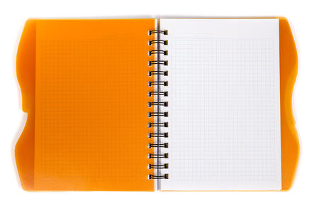 Open diary orange with metal spiral on a white background photo