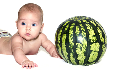 Little baby with watermelon isolated on white photo