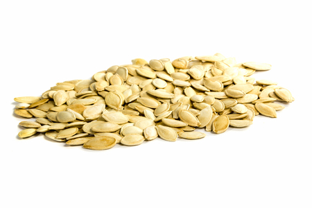 A handful of roasted pumpkin seeds isolated on white background