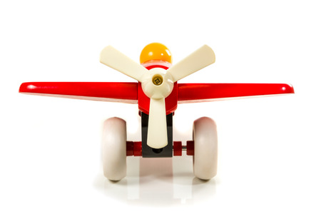 Children toy wooden airplane propeller positioned forward isolated on white background photo