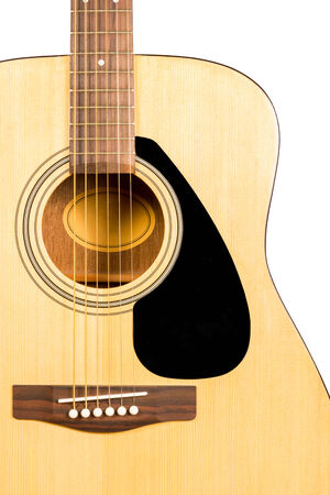 showbusiness: Detail of classic acoustic wooden guitar with strings and soundboard socket brown isolated on white background Stock Photo