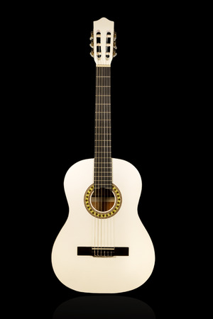 Classical wihite acoustic guitar front view isolated on black background