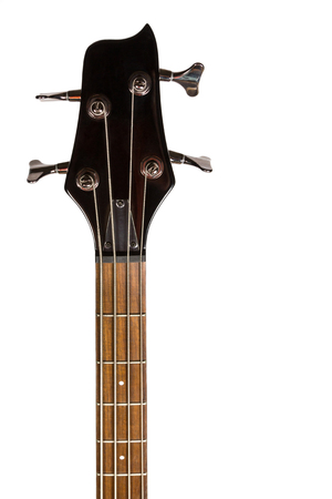 Headstock of the black four string electric bass guitar on white background photo