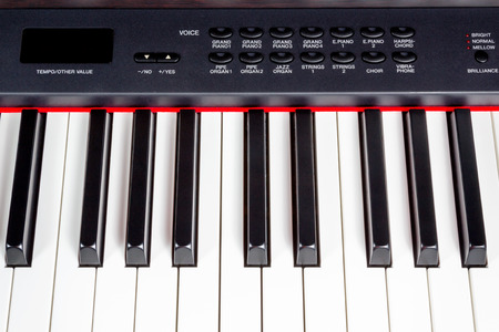 Key electric music synthesizer with a set of buttons of black color photo