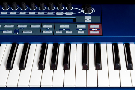 Fragment blue electric music synthesizer with a set of buttons photo