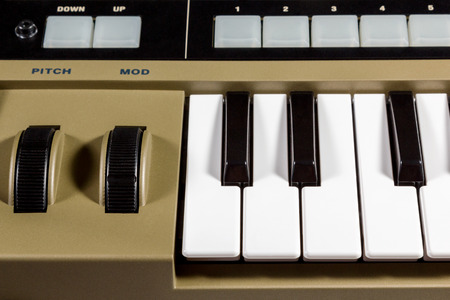 Fragment electric music synthesizer with a set of buttons photo