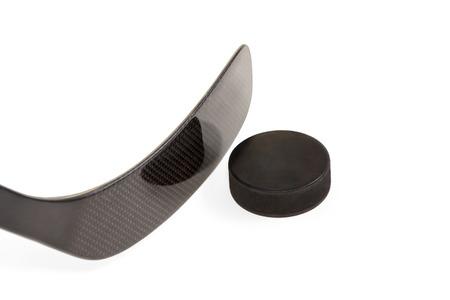 Hockey stick black with washer isolated on a white background photo