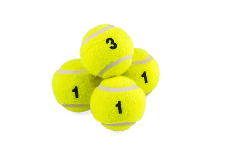 Pyramid of four numbered yellow tennis balls isolated on a white background photo