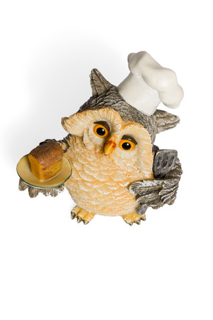 nightcap: Owl figurine cook in a nightcap with bread on the tray top view isolated on a white background