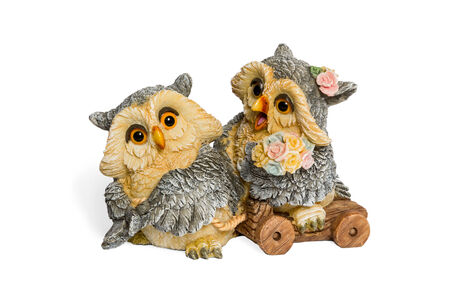 Figurine two lovers owls with flowers isolated on white background photo