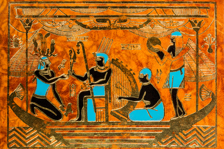 Leather background with ornament Egyptian Pharaoh with musicians photo