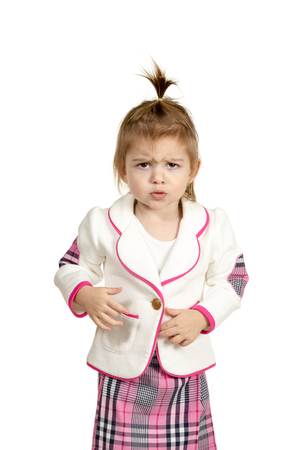 Portrait of a little girl who offended frowned isolated on a white background Standard-Bild