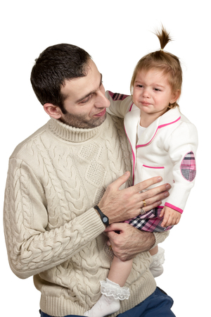 Little girl crying bitterly on his dad hands isolated on white background Stock Photo