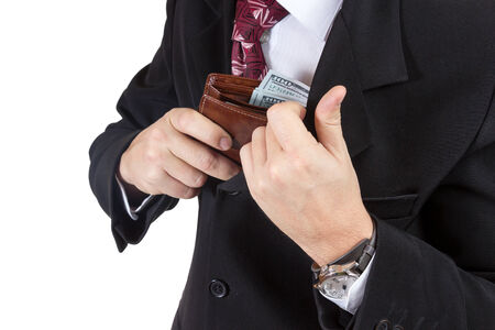 Businessman puts his purse full of money into the inner pocket of his jacket isolated on a white background photo