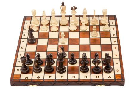 chessboard: Chessboard on which just started a chess battle isolated on a white background