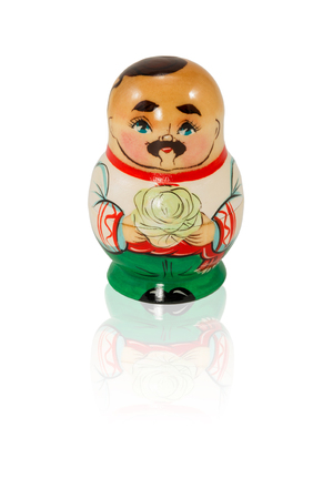 nested: Wooden nested doll Ukrainian man with a mustache and forelock holding cabbage isolated on white background Stock Photo