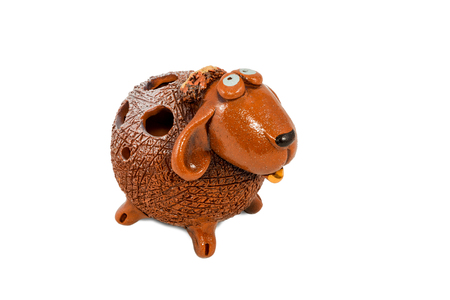 Ceramic figurine funny sheep with the holes on the back isolated on white background photo