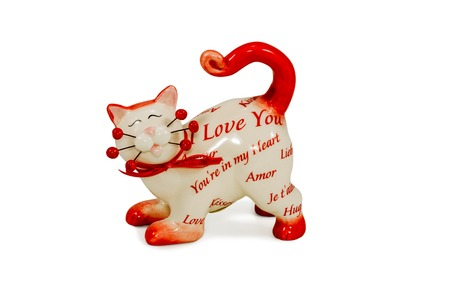 Gift cat statuette with the words Love you isolated on a white background photo