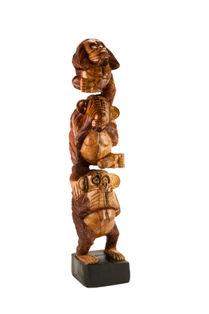 antics: Wooden statue of three monkeys sitting on top of each other isolated on a white background