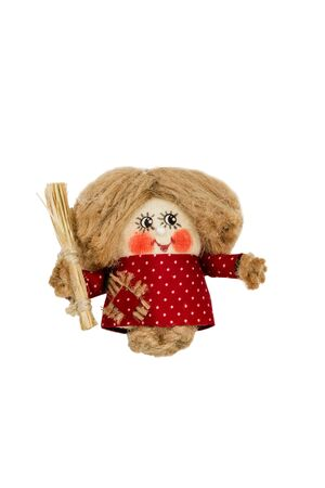 brownie: Hand made rope doll hobgoblin with a broom in his hand isolated on a white background Stock Photo