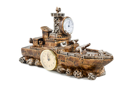 ship with gift: Decorative gift figurine military ship with a clock and thermometer isolated on white background