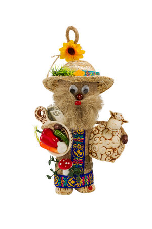 troll dolls: Toy handmade old man with vegetables and sheep in the hands isolated on white background Stock Photo