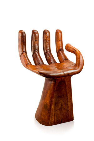 Wooden chair unusual in form of human hands isolated on white background photo
