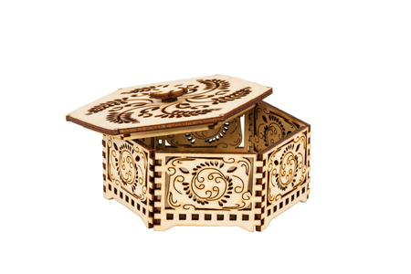 Carved hexagon casket isolated on a white background photo