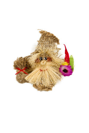 troll dolls: Hand made rope doll hobgoblin with flower in his hand isolated on a white background
