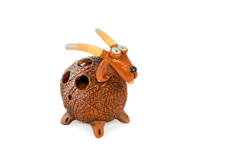 lop: Gift ceramic statuette comical goat isolated on a white background