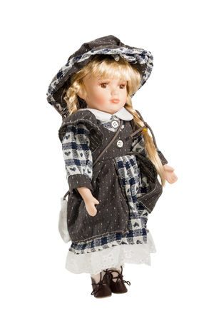 fair complexion: Children enchanting doll in a suit with a bag and a hat isolated on white background