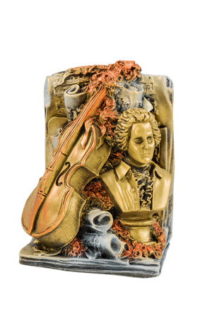 amadeus: Memorial plaque with a bust of Mozart violin and notes isolated on a white background Stock Photo