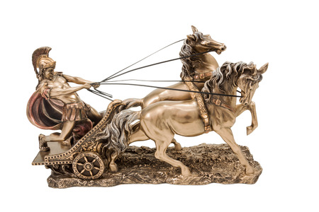Bronze statuette of the Roman war in a chariot with two horses isolated on a white background
