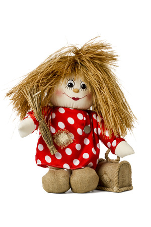 brownie: Hand made rope doll hobgoblin with a broom in his hand in shirt with polka dots isolated on a white background Stock Photo