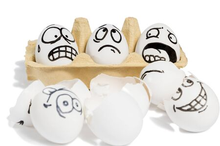funny: Three eggs with frightened faces looking at a broken eggs lying near isolated on white background