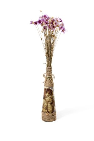 antique vase: Decorative antique vase with dried wildflowers isolated on a white background Stock Photo