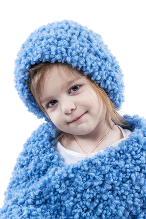 Portrait of girl in a blue scarf and hat isolated on white background photo