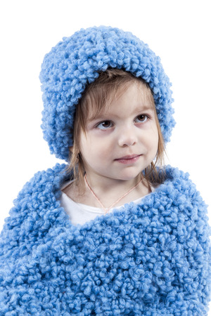 Portrait of girl in a blue winter hat and scarf isolated on white background photo