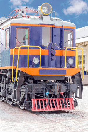 diesel train: Purple vintage diesel train with yellow railing in front Stock Photo