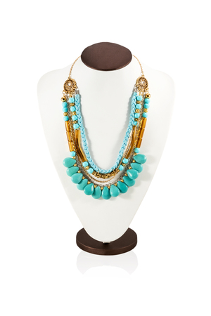inlays: Beautiful necklace handmade with leather pigtails stones beads and gold inlays on the neck mannequin isolated on a white background